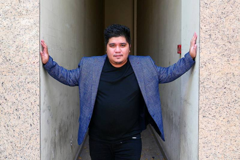 DUBAI , UNITED ARAB EMIRATES , April 15  – 2021 :- Direk Chino, Film writer and director near the Al Ghurair Mall  in Deira in Dubai. Overseas Filipino community have made a film in Dubai with all Filipino cast and production team. ( Pawan Singh / The National ) For News/Online. Story by Nick Webster