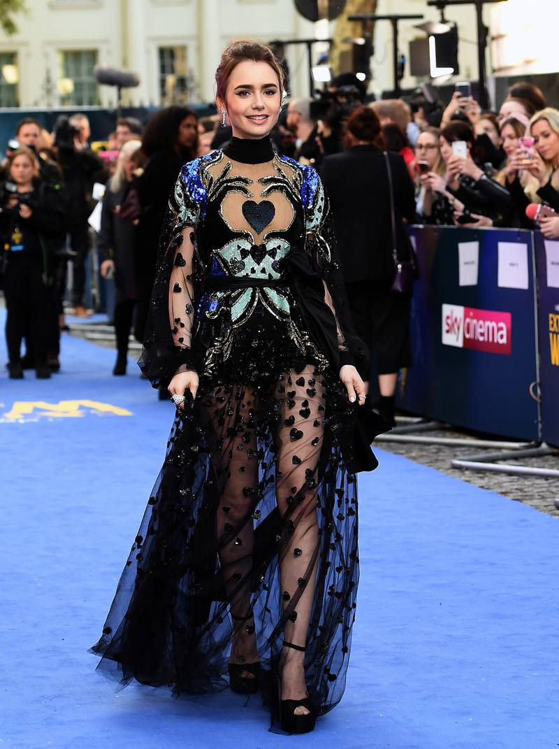 epa07525820 British actress/cast member Lily Collins attends the European premiere of 'Extremely Wicked, Shockingly Evil and Vile' in London, Britain, 24 April 2019. Patterned black sheer dress by Elie Saab. The movie opens in British theaters on 03 May.  EPA-EFE/ANDY RAIN