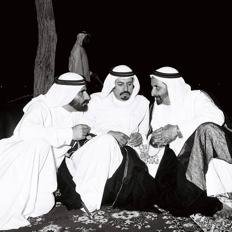 Archival photograph from Al Ittihad. 1980 -  Sheikh Zayed visits the Northern Emirates. (Ittihad folder caption) Courtesy Al Ittihad. Left-right Mohhmed bin Rashid Al Maktoum, Sheikh Hamdan bin Mohammed Al nahyan and Sheikh Rashid.