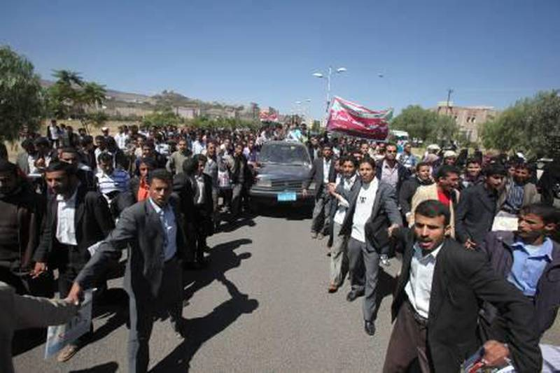 Students surround a car carrying Hanan Mohammed al-Samawi, 22, who was arrested on suspicion of involvement in a plot to send parcel bombs on U.S.-bound planes, as she arrived to a rally protesting her arrest at Sanaa University November 1, 2010. Yemen on Sunday freed a woman suspected of mailing two parcel bombs found on U.S.-bound planes, saying she had been a victim of identity theft. Governments, airlines and aviation authorities around the world are reviewing security after the bombs were intercepted in Dubai and Britain on Friday. REUTERS/Khaled Abdullah (YEMEN - Tags: CIVIL UNREST CRIME LAW POLITICS) *** Local Caption ***  SAN15_USA-YEMEN-_1101_11.JPG