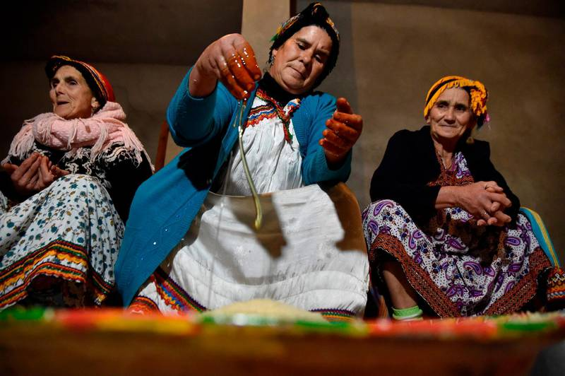Algerian Berber women prepare traditional food as they mark the Yennayer New Year in the village of Ait el-Kecem, south of Tizi-Ouzou, east of the capital Algiers, on January 11, 2018. The Berbers -- an ethnic group descended from the pre-Arab populations across North Africa -- are currently celebrating their New Year festivities. Today -- for the first time -- the Yennayer New Year is being marked as a national holiday in Algeria.   / AFP PHOTO / RYAD KRAMDI