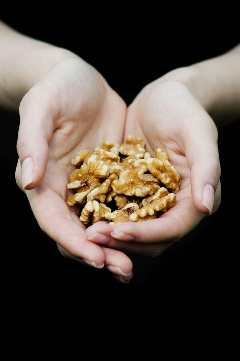 Handful of Walnuts --- Image by © Elisa Lazo de Valdez/Corbis