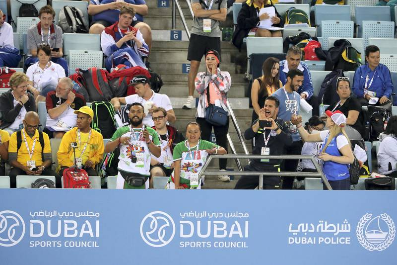 DUBAI , UNITED ARAB EMIRATES , March 20 – 2019 :- Spectators watching the 4x50m freestyle relay at the Special Olympic games held at Hamdan Sports Complex in Dubai. ( Pawan Singh / The National ) For News/Instagram/Online/Big Picture . Story by Ramola