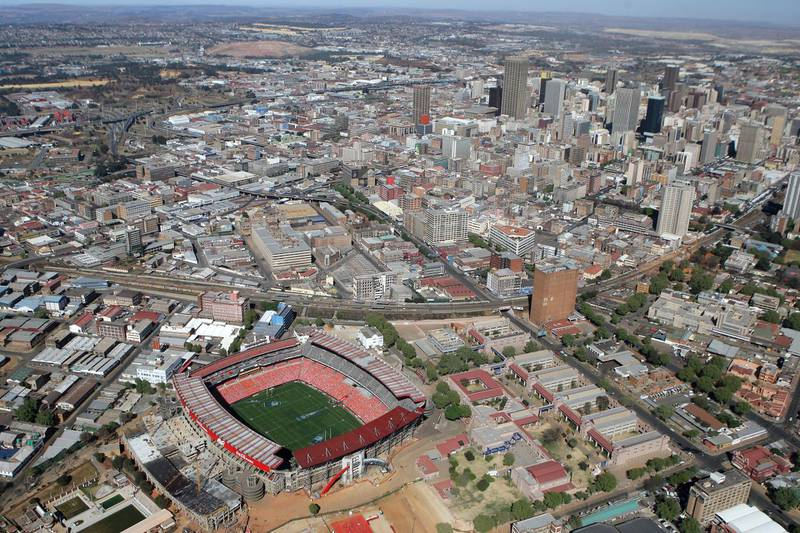 JOHANNESBURG, SOUTH AFRICA - AUGUST 31:  The city skyline rises beyond Ellis Park Stadium, one of the venues for the 2010 Fifa World Cup, on August 31, 2008 in Johannesburg, South Africa.  (Photo by David Rogers/Getty Images)