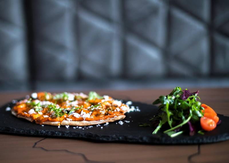 DUBAI, UNITED ARAB EMIRATES.  10 FEBRUARY 2021. Red curry flatbread at the newly opened Dishtrict restaurant in Wasl 51.Photo: Reem Mohammed / The NationalReporter:
