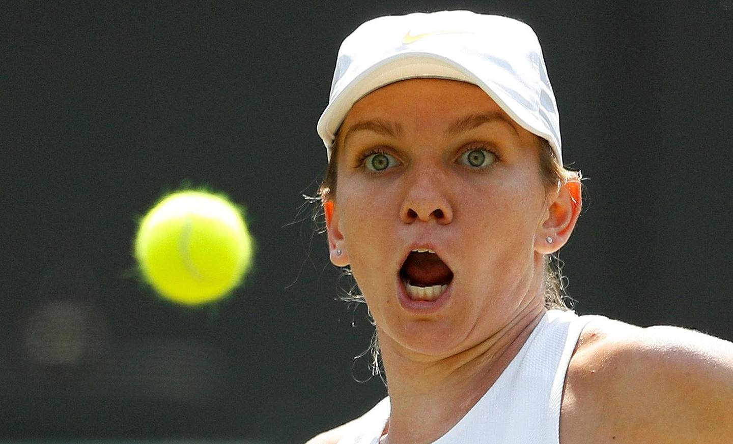 Tennis - Wimbledon - All England Lawn Tennis and Croquet Club, London, Britain - July 7, 2018. Romania's Simona Halep hits a shot during her third round match against Taiwan's Su-Wei Hsieh.  REUTERS/Peter Nicholls     TPX IMAGES OF THE DAY