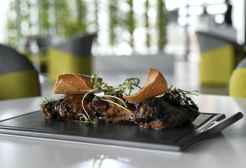 Abu Dhabi, United Arab Emirates - ÔJerk Barbecue WingsÕ served at Kingston 21 Jamaican Restaurant at Al Raha beach. Khushnum Bhandari for The National