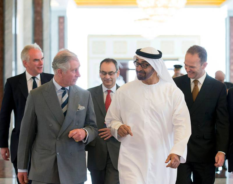 ABU DHABI, UNITED ARAB EMIRATES -February 21, 2014: HH General Sheikh Mohamed bin Zayed Al Nahyan Crown Prince of Abu Dhabi Deputy Supreme Commander of the UAE Armed Forces (R), receives HRH Prince Charles, Prince of Wales (L), at the Presidential Airport prior to a meeting in Abu Dhabi.( Ryan Carter / Crown Prince Court - Abu Dhabi )---