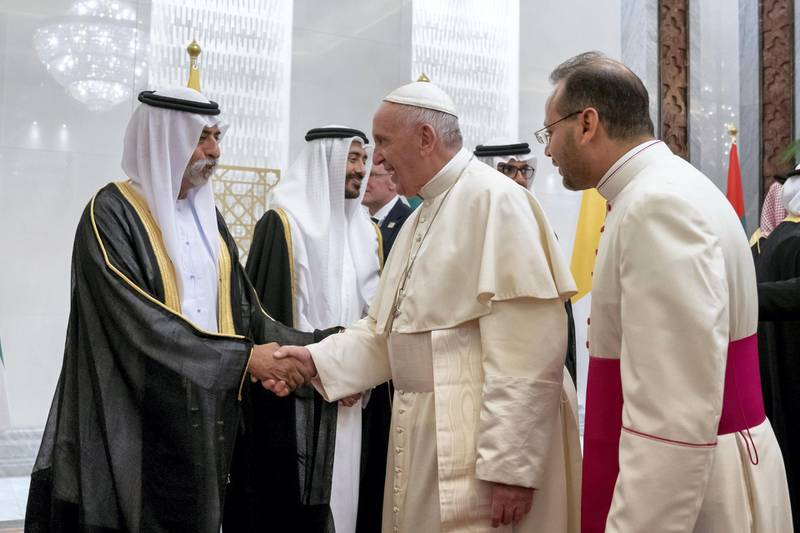 ABU DHABI, UNITED ARAB EMIRATES - February 3, 2019: Day one of the UAE papal visit - HH Sheikh Nahyan bin Mubarak Al Nahyan, UAE Minister of State for Tolerance (L) greets His Holiness Pope Francis, Head of the Catholic Church (2nd R), during his arrival at the Presidential Airport.  ( Mohamed Al Hammadi / Ministry of Presidential Affairs ) ---
