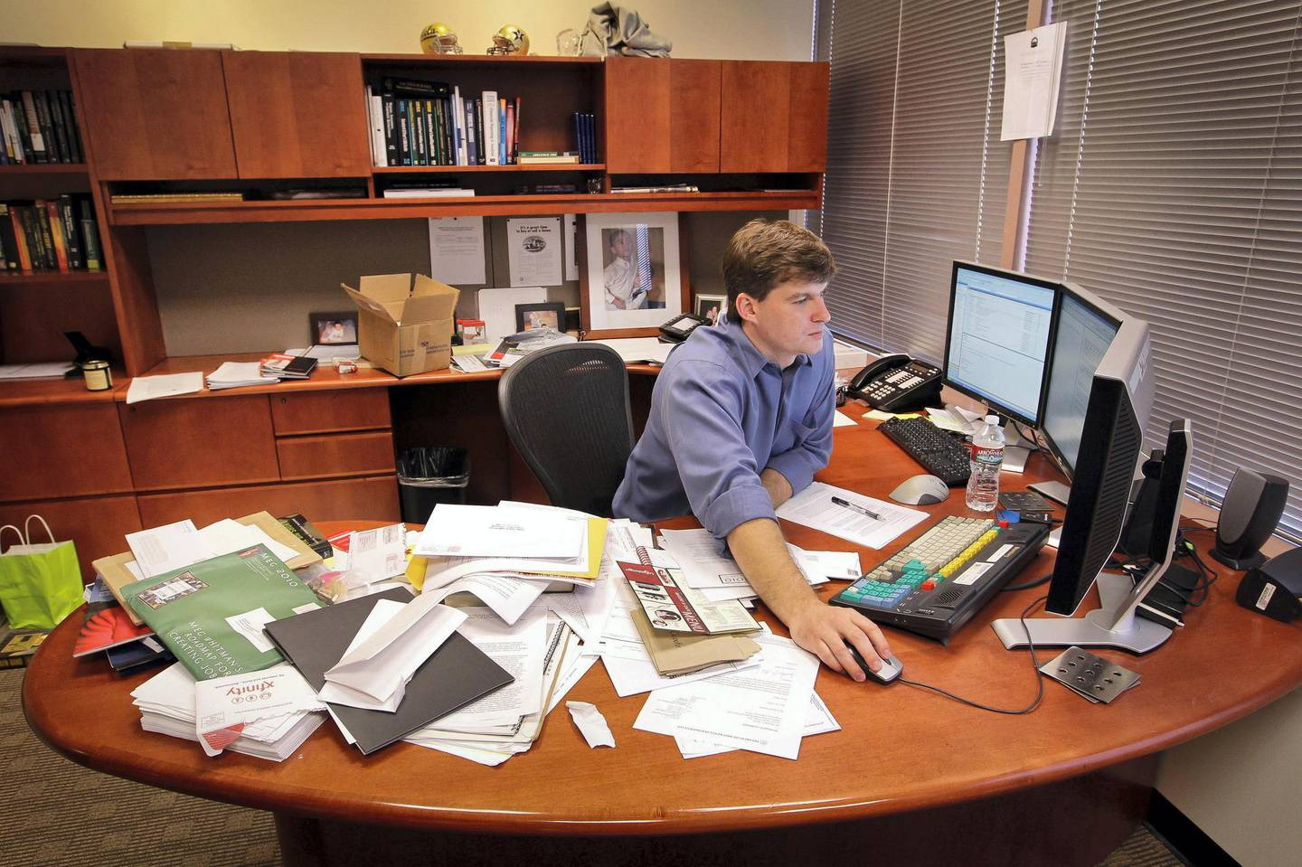 Michael Burry, former head of Scion Capital Group LLC, works in his office in Cupertino, California, U.S., on Monday, Sept. 6, 2010. Burry, the former hedge-fund manager who predicted the housing market's plunge, said he is investing in farmable land, small technology companies and gold as he hunts original ideas and braces for a weaker dollar. Photographer: Tony Avelar/Bloomberg *** Local Caption *** Michael Burry
