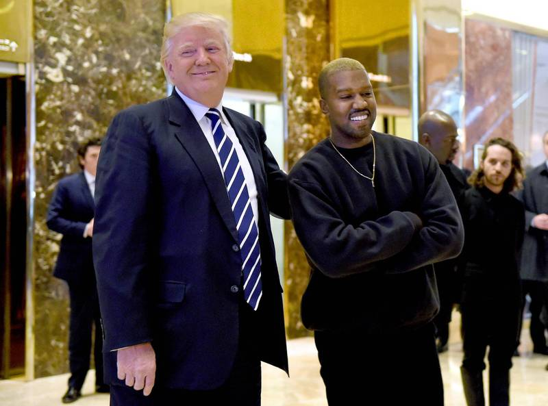 """(FILES) In this file photo taken on December 13, 2016 singer Kanye West and President-elect Donald Trump speak with the press after their meetings at Trump Tower in New York. Kanye West, the entertainment mogul who urges listeners in one song to """"reach for the stars, so if you fall, you land on a cloud,"""" announced SJuly 4, 2020, he is challenging Donald Trump for the US presidency in 2020. / AFP / TIMOTHY A. CLARY"""