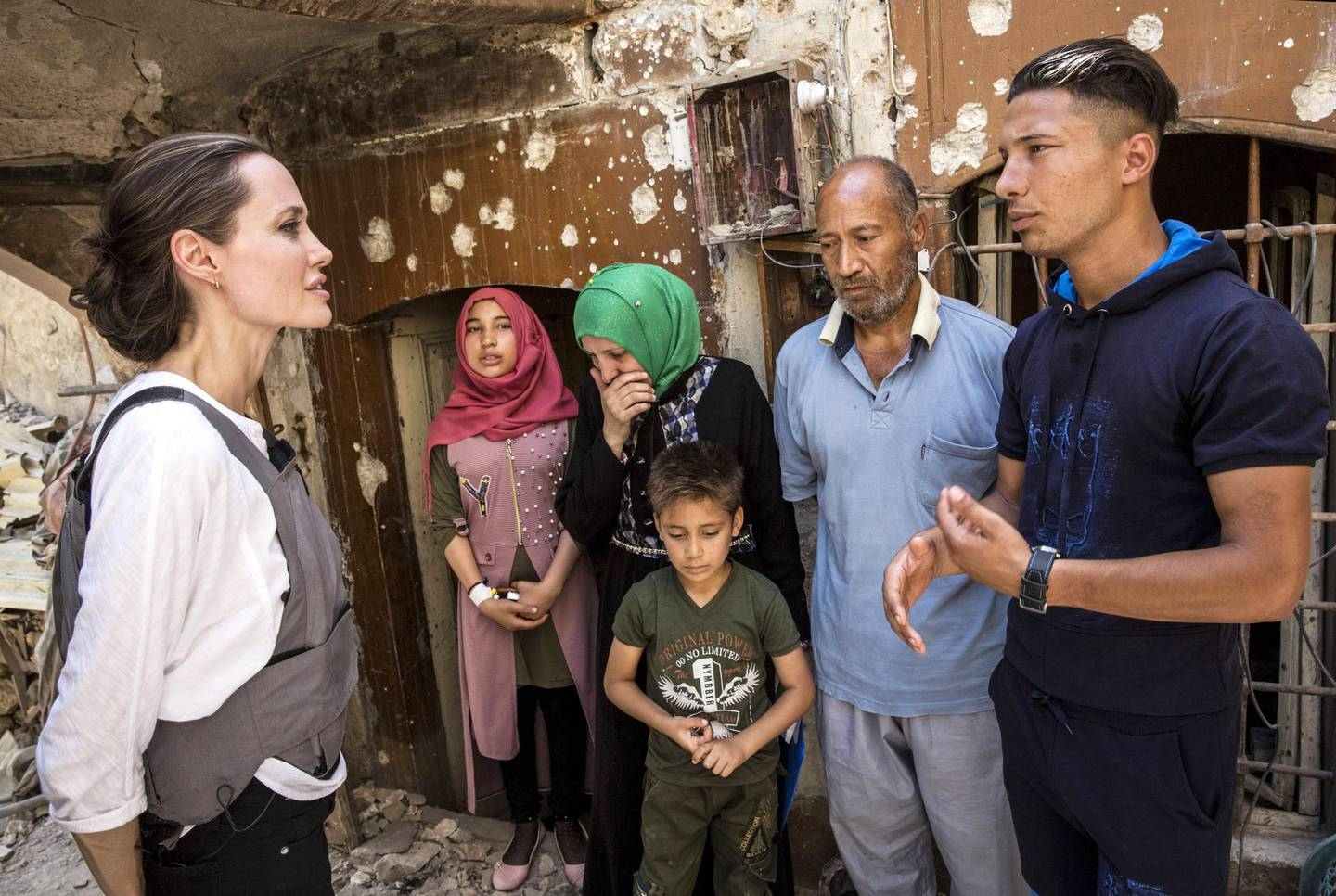 epa06812948 A handout photo made available by the United Nations High Commissioner for Refugees (UNHCR) shows UNHCR Special Envoy Angelina Jolie (L) meets with Mohamed and his family during a visit to the Old City in West Mosul, Iraq, 16 June 2018. During the offensive to retake the city from ISIS Mohamed's house was hit by an airstrike killing his 17 year-old daughter and destroying most of the home. Together with his three surviving children and his wife, Mohamed fled to the home of a family friend, where they have been living ever since. However the host family can no longer support them and Mohamed may have to bring his family back to live in the ruins of their home.  EPA/Andrew McConnell / HANDOUT  HANDOUT EDITORIAL USE ONLY/NO SALES