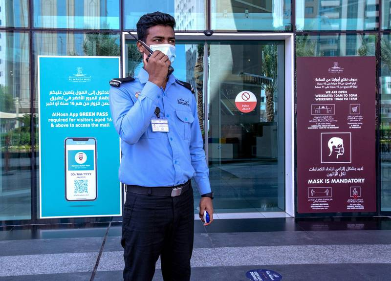 Al Hosn Green Pass awareness signages are put up at the Al Wahda Mall, Abu Dhabi on June 14th, 2021. The new Covid-19 restrictions start tomorrow. Victor Besa / The National.