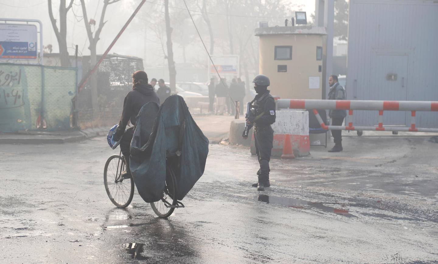 epa07248049 An Afghan soldier secure the area outside the gate of a government building a day after a complex suicide attack in Kabul, Afghanistan, 25 December 2018. According to the ministry of health officials, at least 43 people were killed and 25 others wounded after suicide attackers armed with assault rifles and grenades stormed to a government building.  EPA/JAWAD JALALI