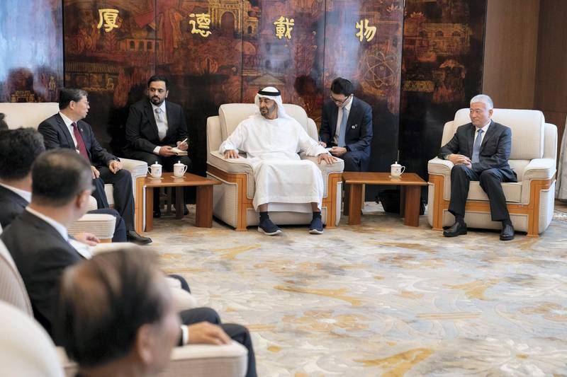 BEIJING, CHINA - July 23, 2019: HH Sheikh Mohamed bin Zayed Al Nahyan, Crown Prince of Abu Dhabi and Deputy Supreme Commander of the UAE Armed Forces (C), meets with Qiu Yong, President of Tsinghua University (L) and Yang Bin, Vice President of Tsinghua University (R), at Tsinghua University.  ( Hamed Al Mansoori for the Ministry of Presidential Affairs ) ---