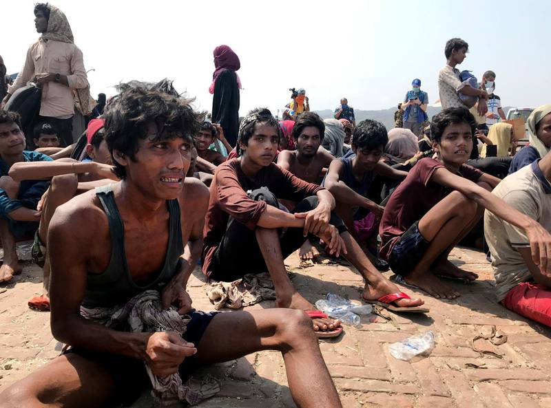 Rohingya refugees react after being rescued in Teknaf near Cox's Bazar, Bangladesh, Thursday, April 16, 2020. Bangladesh's coast guard has rescued 382 starving Rohingya refugees who had been drifting at sea for weeks after failing to reach Malaysia, officials said Thursday. (AP Photo/Suzauddin Rubel)