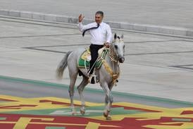 Turkmenistan's president rides horse in colourful 30th anniversary parade