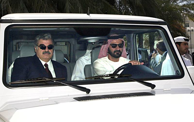 Crown Prince of Dubai Mohammed bin Rashed al Maktoum (R) drives former Lebanese Premier and head of the Lebanese parliamentary opposition Rafic Hariri in Dubai 06 March 2000. Hariri is on a two-day visit to the Emirate. (Photo by AYMAN TARAWI / HARIRI FOUNDATION / AFP)