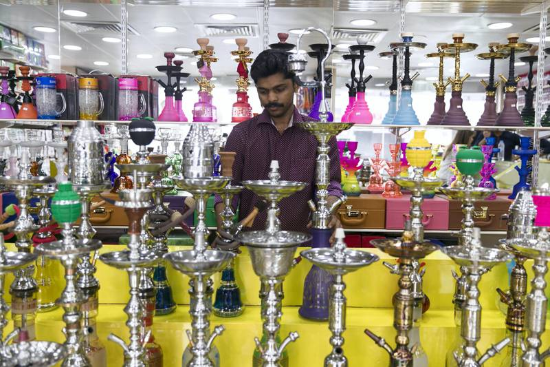 ABU DHABI, UNITED ARAB EMIRATES - SEP 27:Shisha for sale at Hatta Smoking Accessories shop.Cigarettes, energy and soft drinks are going to be expensive as the UAE is all set to implement Excise Tax on October 1, 2017.The Federal Tax Authority on Wednesday announced that the authority is all set to implement Excise Tax in the country from next week. On October 1, the excise tax will go into effect at a rate of 100 per cent on tobacco and energy drinks that include stimulants or substances that induce mental or physical stimulation, such as caffeine, taurine, ginseng and gaurana. The tax also will go into effect on soft drinks, at a rate of 50 per cent.(Photo by Reem Mohammed/The National)Reporter: Anna ZachariasSection: NA