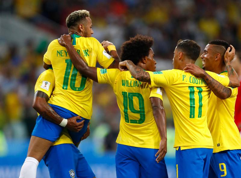 Brazil players celebrates after their teammate Brazil's Paulinho, left, scores his side's first goal during the group E match between Serbia and Brazil, at the 2018 soccer World Cup in the Spartak Stadium in Moscow, Russia, Wednesday, June 27, 2018. (AP Photo/Matthias Schrader)