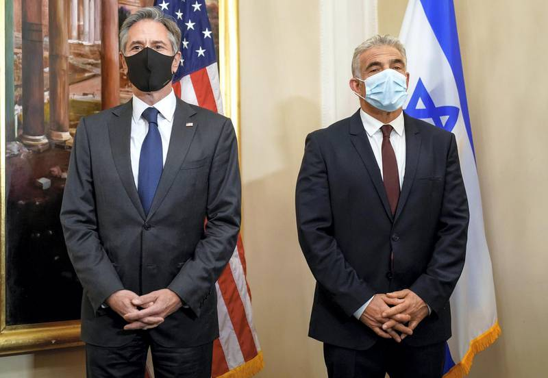 U.S. Secretary of State Antony Blinken and Israeli Foreign Minister Yair Lapid pose for a picture as they meet in Rome, Italy, June 27, 2021. Andrew Harnik/Pool via REUTERS