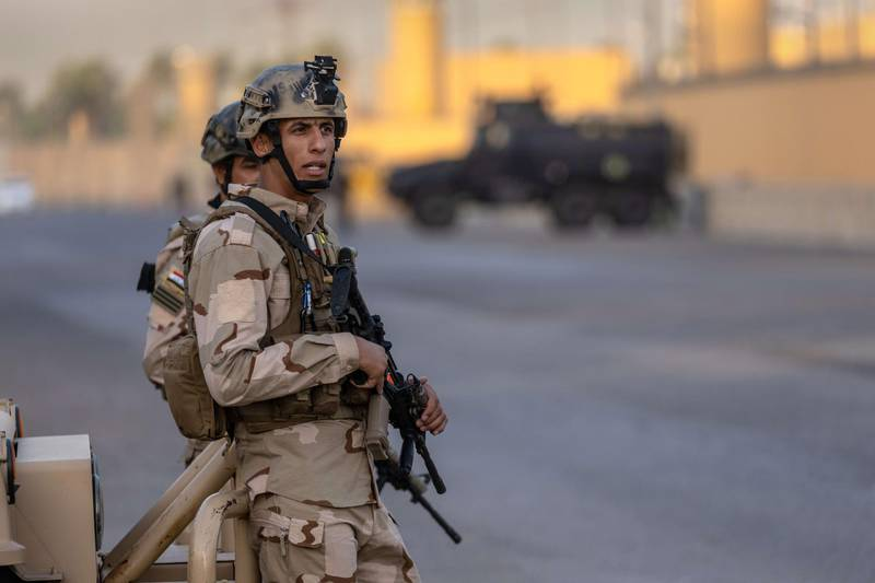 BAGHDAD, IRAQ - MAY 30: Iraqi Army soldiers stand guard on a road between the U.S. Embassy and the International Zone on May 30, 2021 in Baghdad, Iraq. Coalition forces based in Baghdad's International Zone are part of the U.S.-led Military Advisor Group of 13 nations supporting the Iraqi Security Forces. The United States currently maintains 2,500 military personnel in Iraq as part of Operation Inherent Resolve.   John Moore/Getty Images/AFP == FOR NEWSPAPERS, INTERNET, TELCOS & TELEVISION USE ONLY ==
