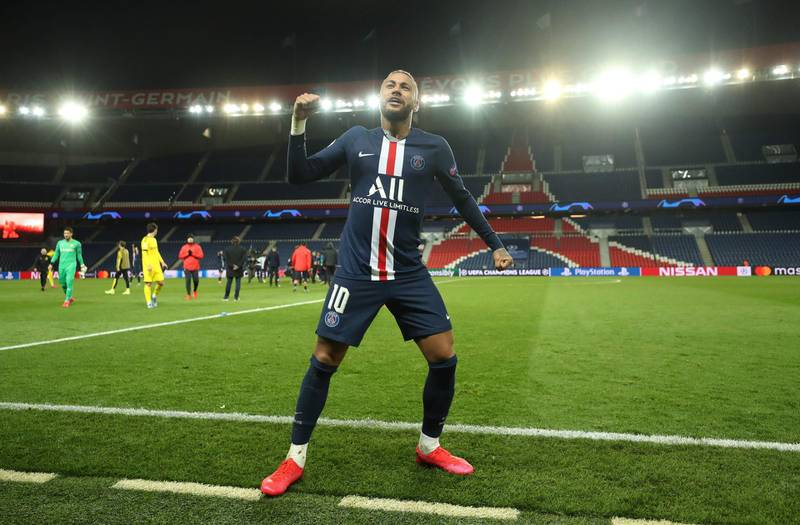 """This handout photograph taken and released by the UEFA on March 11, 2020, shows  Paris Saint-Germain's Brazilian forward Neymar celebrating after winning the   UEFA Champions League round-of-16 second leg football match between Paris Saint-Germain (PSG) and Borussia Dortmund at the Parc des Princes stadium in Paris. The match is held behind closed doors due to the spread of COVID-19, the new coronavirus. - RESTRICTED TO EDITORIAL USE - MANDATORY CREDIT """"AFP PHOTO / GETTY / UEFA"""" - NO MARKETING NO ADVERTISING CAMPAIGNS - DISTRIBUTED AS A SERVICE TO CLIENTS    / AFP / GETTY/UEFA / - / RESTRICTED TO EDITORIAL USE - MANDATORY CREDIT """"AFP PHOTO / GETTY / UEFA"""" - NO MARKETING NO ADVERTISING CAMPAIGNS - DISTRIBUTED AS A SERVICE TO CLIENTS"""