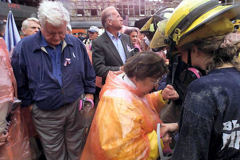 US Senators Ted Kennedy (L), D-MA, Joe Biden (C), D-DE, and Barbara Mikulski (R), D-MD, tour ground zero 20 September 2001 in New York, nine days after the destruction of the World Trade Center. Only five people have been found alive since the landmark twin towers collapsed on the morning of 11 September after being hit by two hijacked airliners in fireballs that buckled steel girders.   AFP PHOTO/POOL/NEW YORK DAILY NEWS/MIKE ALBANS (Photo by MIKE ALBANS / NEW YORK DAILY NEWS / AFP)