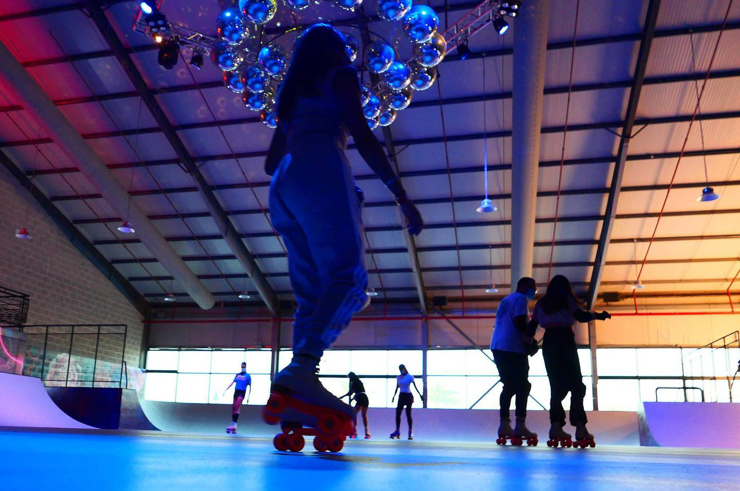 People doing roller skating at the RollDXB roller disco which opens at Shed 3 Marina Cubes Street, Dubai Maritime City, Port Rashid, Bur Dubai on April 25,2021. (Pawan Singh/The National). Story by Sophie Prideaux