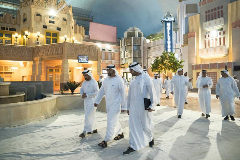 YAS ISLAND, ABU DHABI, UNITED ARAB EMIRATES -  March 1, 2018: HH Sheikh Mohamed bin Zayed Al Nahyan, Crown Prince of Abu Dhabi and Deputy Supreme Commander of the UAE Armed Forces (2nd L), inspects construction of Warner Bros World Abu Dhabi with HE Mohamed Khalifa Al Mubarak Chairman of the Department of Culture and Tourism and Abu Dhabi Executive Council Member (3rd L), and Mohamed Abdalla Al Zaabi CEO of Miral (L).  ( Ryan Carter for the Crown Prince Court - Abu Dhabi ) ---