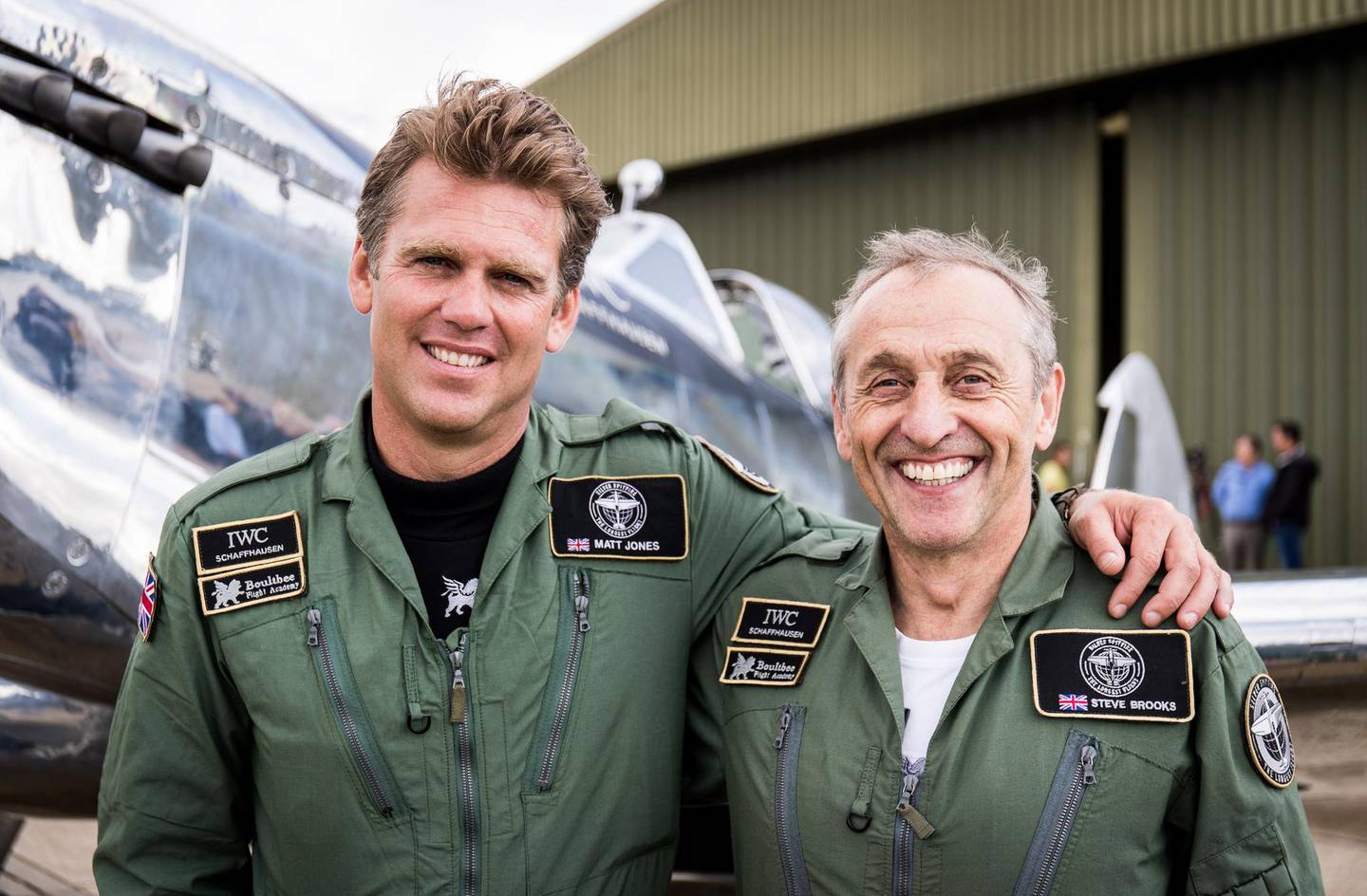 epa07758555 A handout picture provided by the British Ministry of Defence (MOD) showing Matt Jones (L) and Steve Brooks (R) in front of their Silver Spitfire before taking off on their round the world flight, at Goodwood Aerodrome, Hampshire, southern England, 05 August 2019, issued 06 August 2019. The MOD report that in 2019 the two aviators will attempt to fly a Silver Spitfire around the world, taking in some of the most famous landmarks on the planet from the Grand Canyon in the West to the snow-capped peak of Mount Fuji in the East. The Spitfire is a British treasure and an emblem of freedom across the globe. The Silver Spitfire expedition will hopefully promote the 'Best of British' worldwide showcasing the nation's heritage in engineering excellence, and an aircraft that changed the course of history. The Spitfire embodies not only a pinnacle in aerospace engineering and design but commemorates a generation of intrepid aviators prepared to stand up to oppression and make the ultimate sacrifice in pursuit of freedom. The expedition will reunite the Spitfire with the many countries that owe their freedom, at least in part, to this iconic aircraft. The unmistakable sight and sound of this aircraft once again gracing the skies aims to inspire future generations more than eighty years after R.J. Mitchell's timeless design first graced the skies.  EPA/SAC ED WRIGHT RAF / BRITISH MINISTRY OF DEFENCE / HANDOUT MANDATORY CREDIT: MOD/CROWN COPYRIGHT HANDOUT EDITORIAL USE ONLY/NO SALES