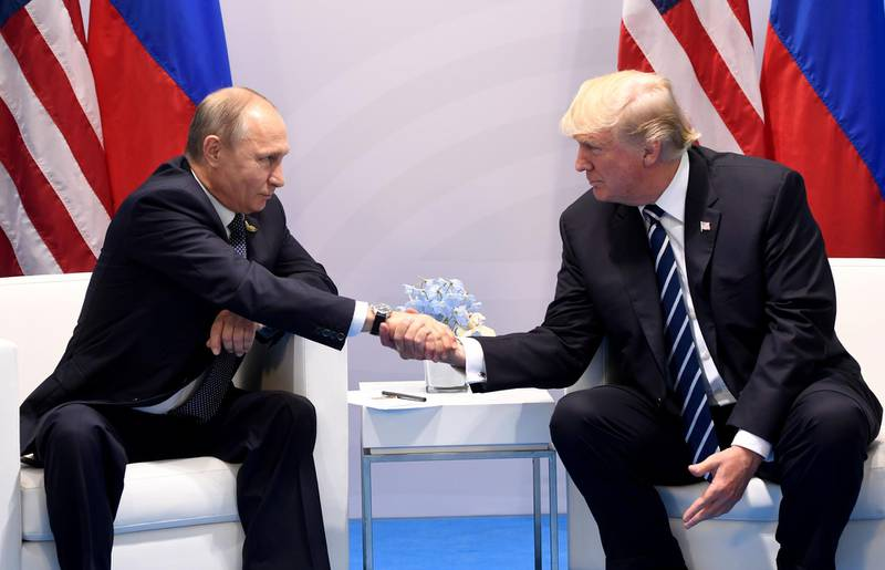 """(FILES) In this file photo taken on July 7, 2017, US President Donald Trump and Russia's President Vladimir Putin shake hands during a meeting on the sidelines of the G20 Summit in Hamburg, Germany. A long-awaited summit between US President Donald Trump and his Russian counterpart Vladimir Putin will take place in Helsinki on July 16, the Kremlin said in a statement. """"An agreement has been reached that on July 16 in Helsinki there will be a meeting between the President of the Russian Federation Vladimir Putin and the President of the United States Donald Trump,"""" the statement said.  / AFP / SAUL LOEB"""