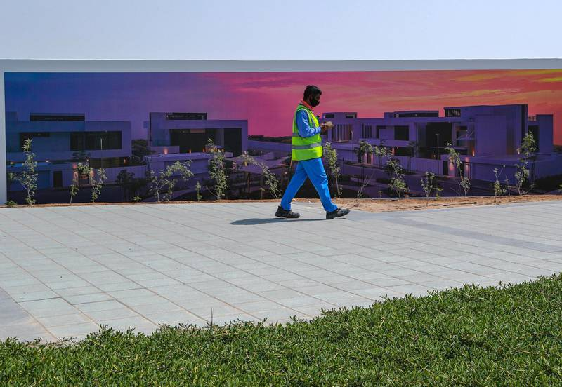 Abu Dhabi, United Arab Emirates, March 2, 2021.   Stock images of Yas residential areas.A worker walks along a bike lane at Yas North.Victor Besa / The NationalSection:  NA