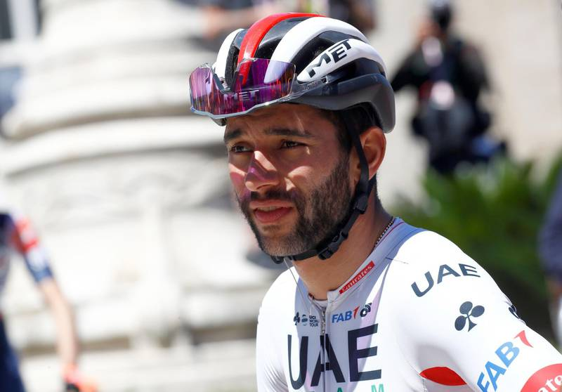 (FILES) In this file photo taken on May 17, 2019 team UAE Emirates rider Colombia's Fernando Gaviria is picture before taking the start of stage seven of the 102nd Giro d'Italia - Tour of Italy - cycle race, 185kms from Vasto to L'Aquila. Some celebrities around the world are affected by the novel coronavirus such as Fernando Gaviria. He was tested positive to the Covid-19. / AFP / Luk BENIES