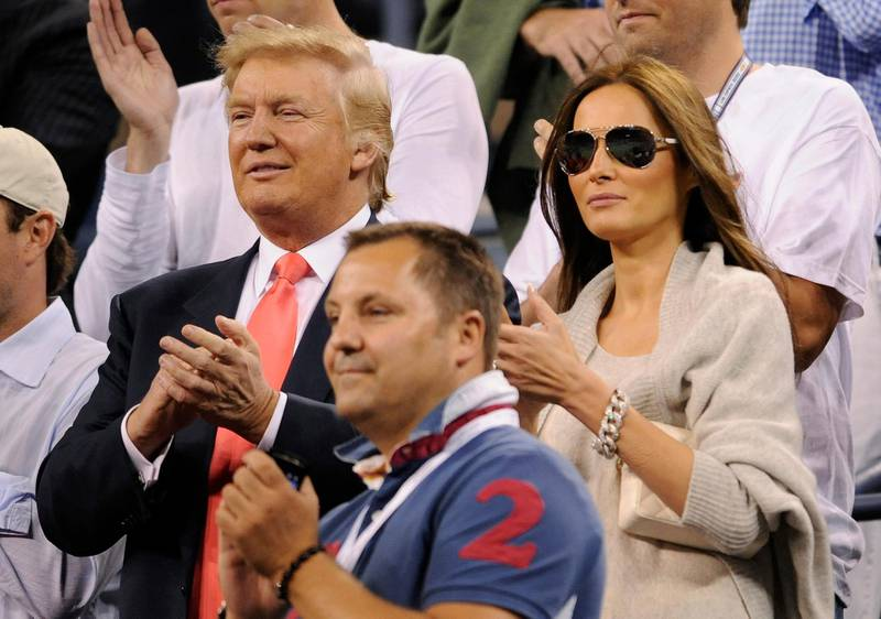 epa02323729 Donald Trump (L) and his wife Melania Knauss (R) applaud after Caroline Wozniacki, of Denmark, defeated Dominika Cibulkova, of Slovakia, during their quarterfinal match at the 2010 US Open Tennis Championship at the USTA National Tennis Center in Flushing, Meadows, New York, USA, on 08 September 2010. The US Open Championship runs through 12 September when the men's final is scheduled to be played.  EPA/JUSTIN LANE