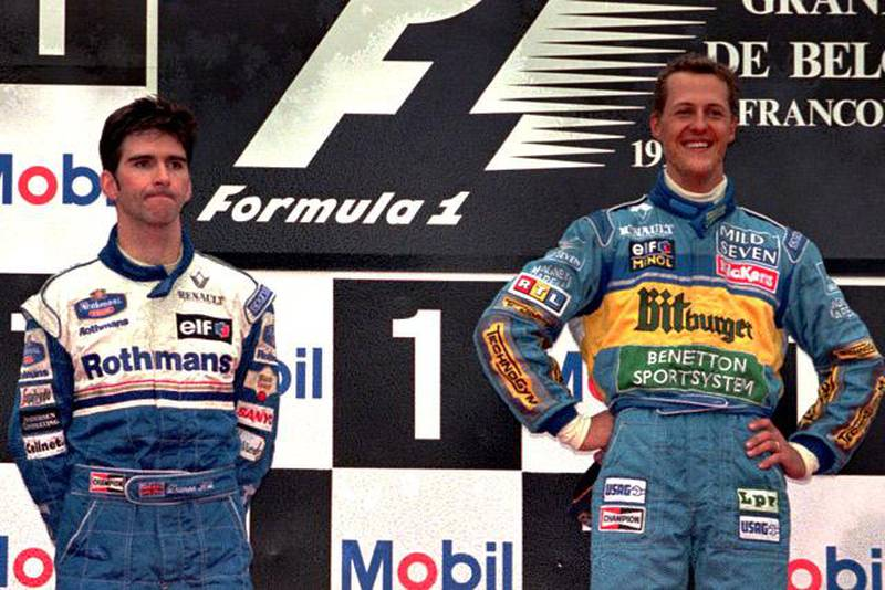 Defending champion Michael Schumacher of Germany, right, is all smiles celebrating his victory in the Belgium F1  Grand Prix next to second-placed Damon Hill  on the podium in Spa-Francorchamps Sunday August 27, 1995.(AP Photo/Dusan Vranic)