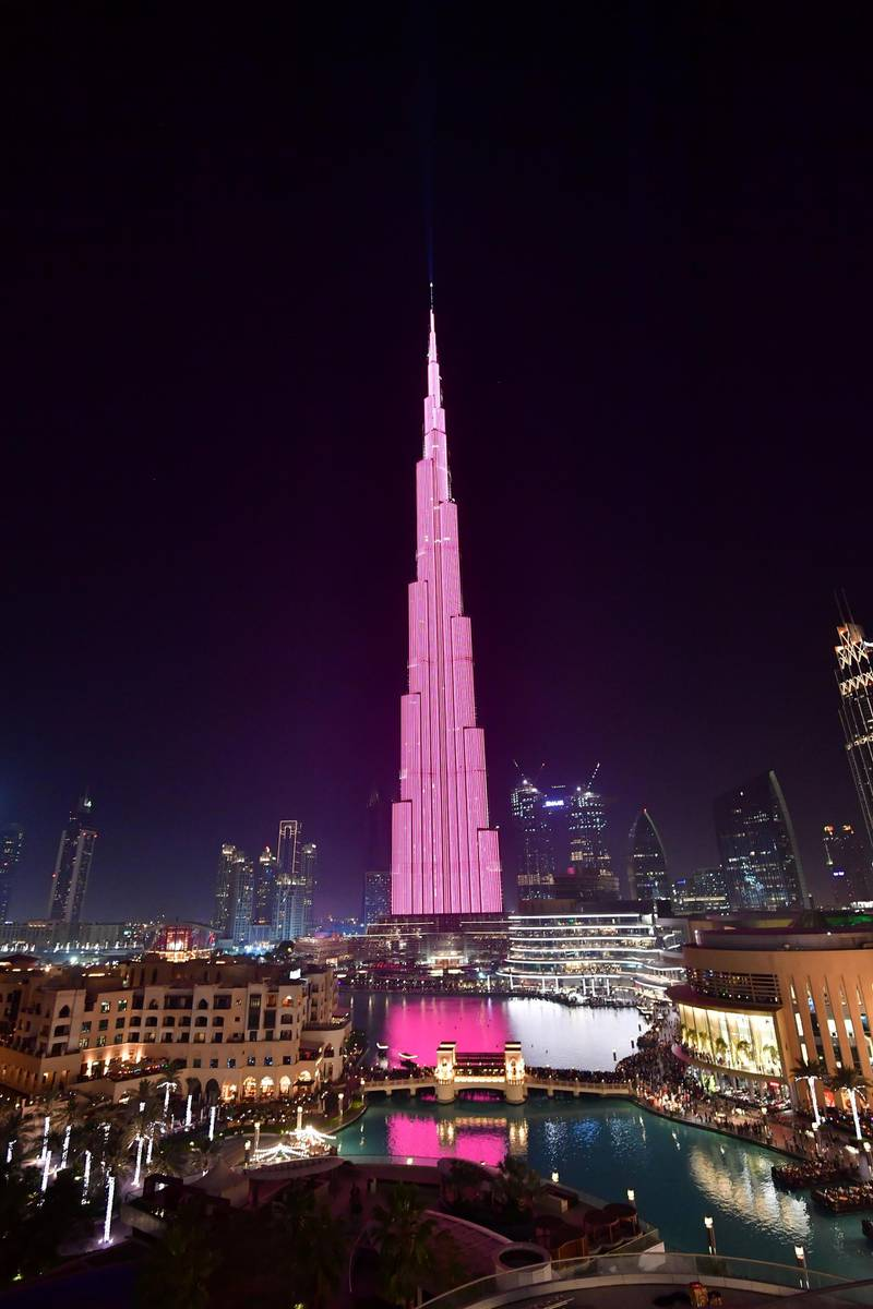 A picture taken on March 29, 2018 shows a laser show on the Burj Khalifa, the tallest tower in the world, in downtown Dubai. (Photo by GIUSEPPE CACACE / AFP)