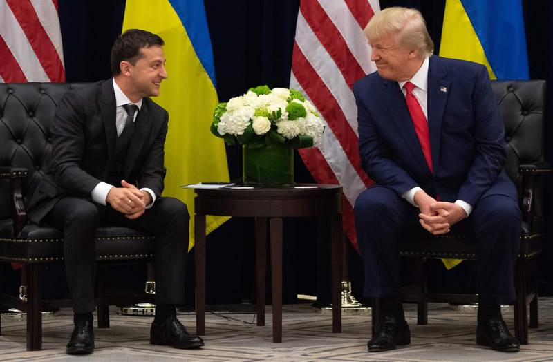 (FILES) In this file photo taken on September 25, 2019 US President Donald Trump and Ukrainian President Volodymyr Zelensky speak during a meeting in New York  on the sidelines of the United Nations General Assembly. Donald Trump faces the prospect of becoming only the third US president to be impeached when open hearings begin this week into his alleged effort to bolster his re-election hopes by pushing Ukraine to find dirt on a Democratic rival. / AFP / SAUL LOEB