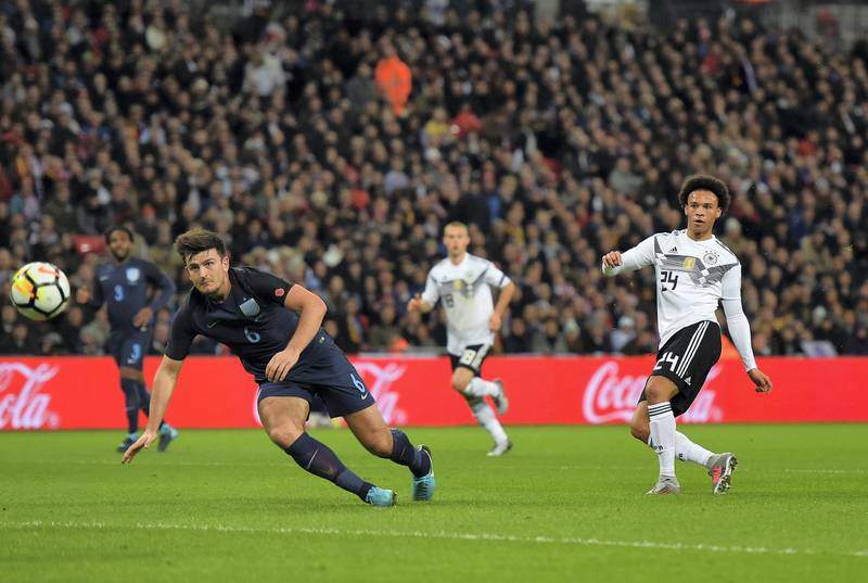 LONDON, ENGLAND - NOVEMBER 10: Leroy Sane of Germany shoots as Harry Maguire of England blocks during the International friendly match between England and Germany at Wembley Stadium on November 10, 2017 in London, England.  (Photo by Mike Hewitt/Bongarts/Getty Images)