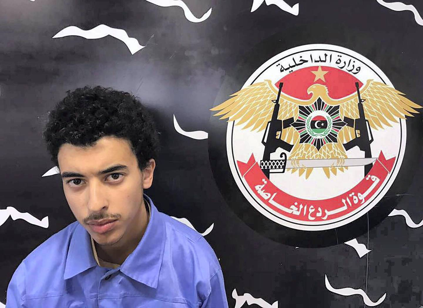 """A photo released on the Facebook page of Libya's Ministry of Interior's Special Deterrence Force on May 24, 2017 claims to shows Hashem Abedi, the brother of the man suspected of carrying out the bombing in the British city of Manchester, after he was detained in Tripoli for alleged links to the Islamic State (IS) group. - Libya arrested a brother and father of Salman Abedi who is suspected of the bombing at a pop concert killing 22 people, including children on May 22, 2017. (Photo by HO / LIBYA'S SPECIAL DETERRENCE FORCE / AFP) / RESTRICTED TO EDITORIAL USE - MANDATORY CREDIT """"AFP PHOTO / LIBYA'S SPECIAL DETERRENCE FORCE"""" - NO MARKETING NO ADVERTISING CAMPAIGNS - DISTRIBUTED AS A SERVICE TO CLIENTS"""