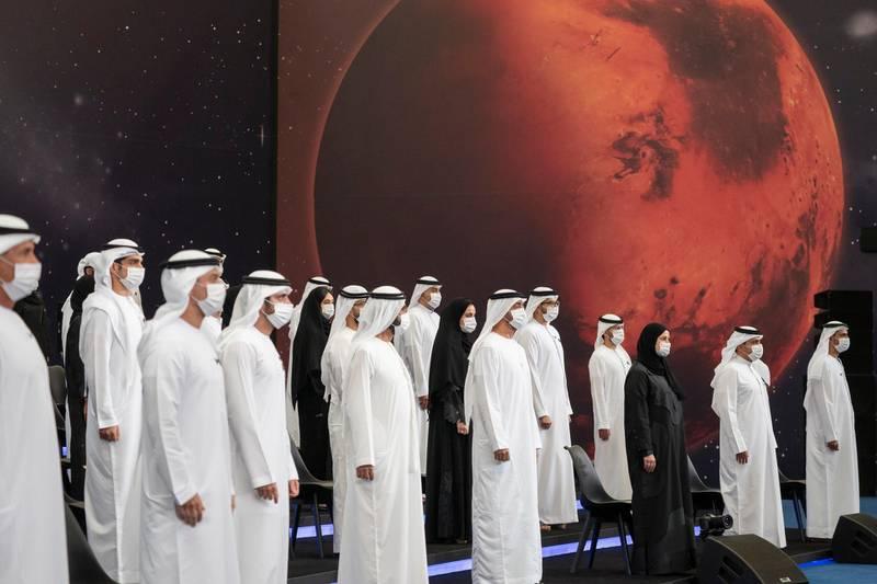 ABU DHABI, UNITED ARAB EMIRATES - July 31, 2020: HH Sheikh Mohamed bin Zayed Al Nahyan, Crown Prince of Abu Dhabi and Deputy Supreme Commander of the UAE Armed Forces front (front row 5th L), HH Sheikh Mohamed bin Rashid Al Maktoum, Vice-President, Prime Minister of the UAE, Ruler of Dubai and Minister of Defence (front row 4th L) and HH Sheikh Hamdan bin Mohamed Al Maktoum, Crown Prince of Dubai (front row 3rd L), stand for a photograph with the Hope Probe team, during an honoring ceremony, at Qasr Al Watan.  ( Hamad Al Kaabi / Ministry of Presidential Affairs ) ---