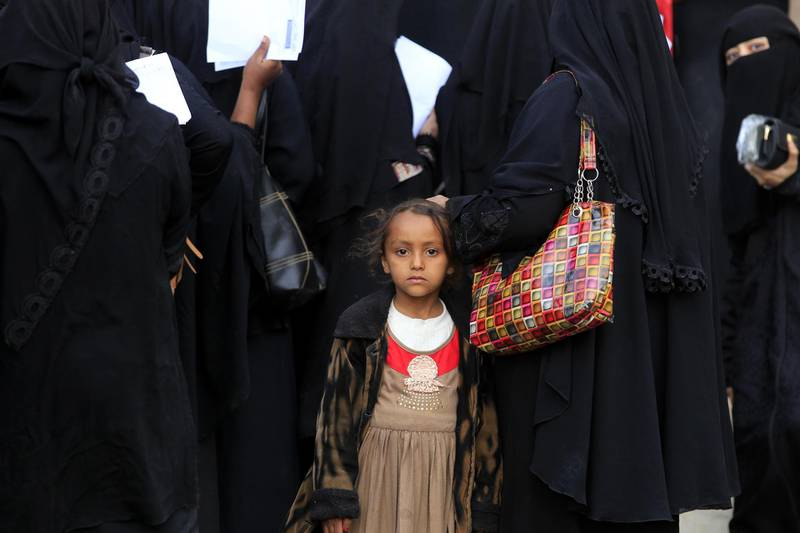epaselect epa07173835 A Yemeni child stands amongst displaced people gathering to register at an evacuation center after fleeing home due to ongoing conflict, in Sana'a, Yemen, 17 November 2018. According to reports, the UN envoy for Yemen Martin Griffiths has said that the Saudi-backed Yemeni government and Houthi rebels have agreed to attend peace talks in Sweden before the end of November 2018 aimed at ending more than three years of Yemen's conflict that has driven millions to the brink of famine.  EPA/YAHYA ARHAB