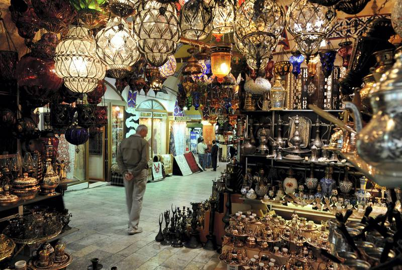 ISTANBUL, TURKEY - APRIL 02:  A man strolls past market stalls inside the Grand Bazaar on April 2, 2009 in Istanbul, Turkey. The Grand Bazaar is with it's around 58 streets and over 1200 shops one of the largest covered markets in the world attracting around 300,000 people daily.  (Photo by Jasper Juinen/Getty Images)