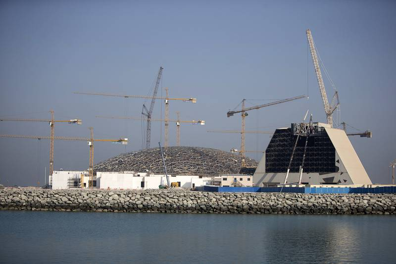 ABU DHABI, UNITED ARAB EMIRATES, Sep. 21, 2014:  (R) The skeleton of the Rain of Light mockup building, which sits directly next to the actual construction of Louvre Abu Dhabi at the site on Saadiyat Island in Abu Dhabi, is seen exposed as work has begun on its demolition. Seen here on Sunday, Sep. 21, 2014, is the top part of the mock up, the about 40-ton super-sized element, which has to be cut piece by piece, in a precise order so that the whole structure doesn't collapse on itself. With just over a year left for the completion of Louvre AbU Dhabi, work will be shifting from the construction of the large structures to further and further refining the future gallery into its final polished state.  (Silvia Razgova / The National)Usage: undated, RESTRICTEDSection: NAReporter: Nick Leech