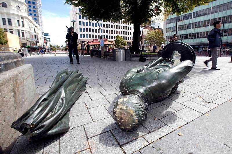 A toppled statue of John Robert Godley in Cathedral Square on February 24, 2011, two days after a deadly 6.3 magnitude earthquake rocked Christchurch. AFP