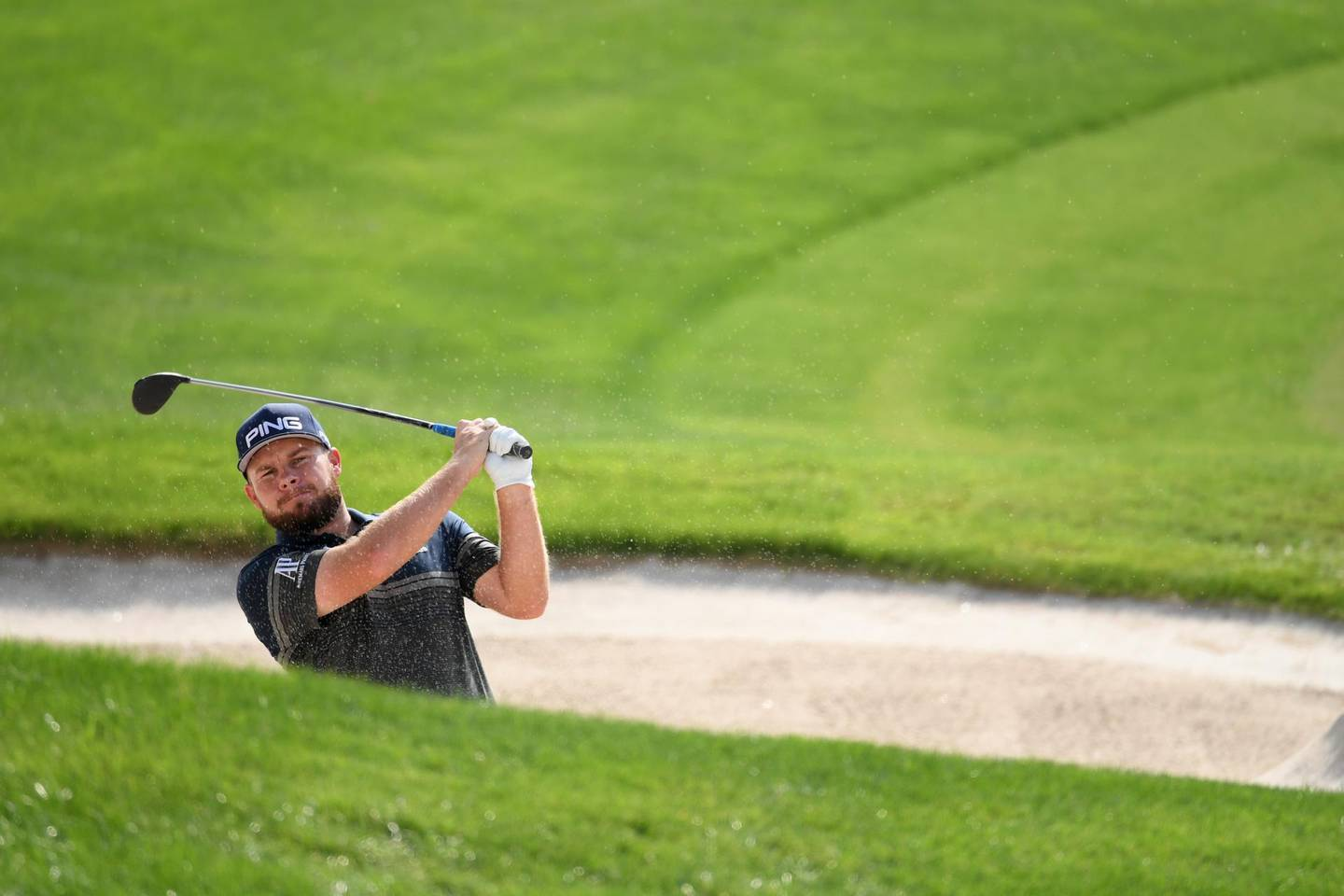 DUBAI, UNITED ARAB EMIRATES - NOVEMBER 19:  Tyrrell Hatton of England hits a bunker shot  during practice prior to the DP World Tour Championship Dubai at Jumeirah Golf Estates on November 19, 2019 in Dubai, United Arab Emirates. (Photo by Ross Kinnaird/Getty Images)