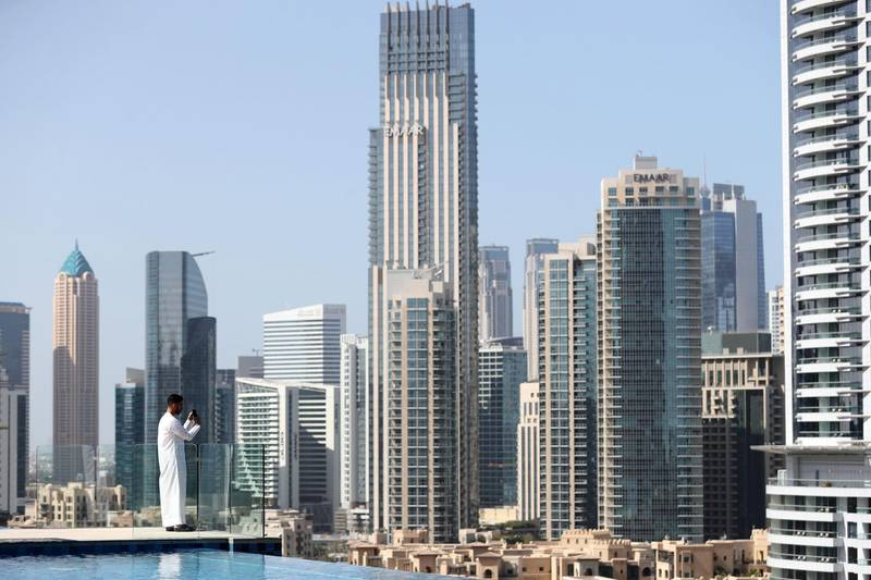 Dubai, United Arab Emirates - Reporter: N/A: A visitor to the Address Fountain Views Hotel takes pictures of Downtown Dubai. Tuesday, 3rd of March, 2020. Downtown, Dubai. Chris Whiteoak / The National