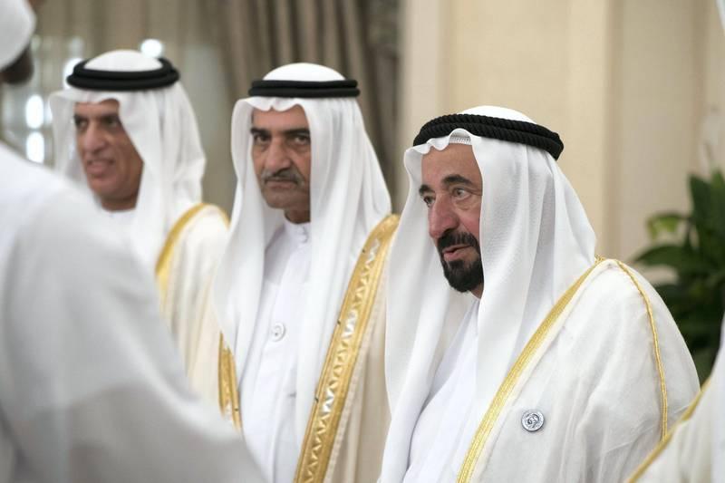 ABU DHABI, UNITED ARAB EMIRATES - August 21, 2018: HH Dr Sheikh Sultan bin Mohamed Al Qasimi, UAE Supreme Council Member and Ruler of Sharjah (R) and HH Sheikh Hamad bin Mohamed Al Sharqi, UAE Supreme Council Member and Ruler of Fujairah (2nd R) attend an Eid Al Adha reception at Mushrif Palace.  ( Mohamed Al Hammadi / Crown Prince Court - Abu Dhabi ) ---