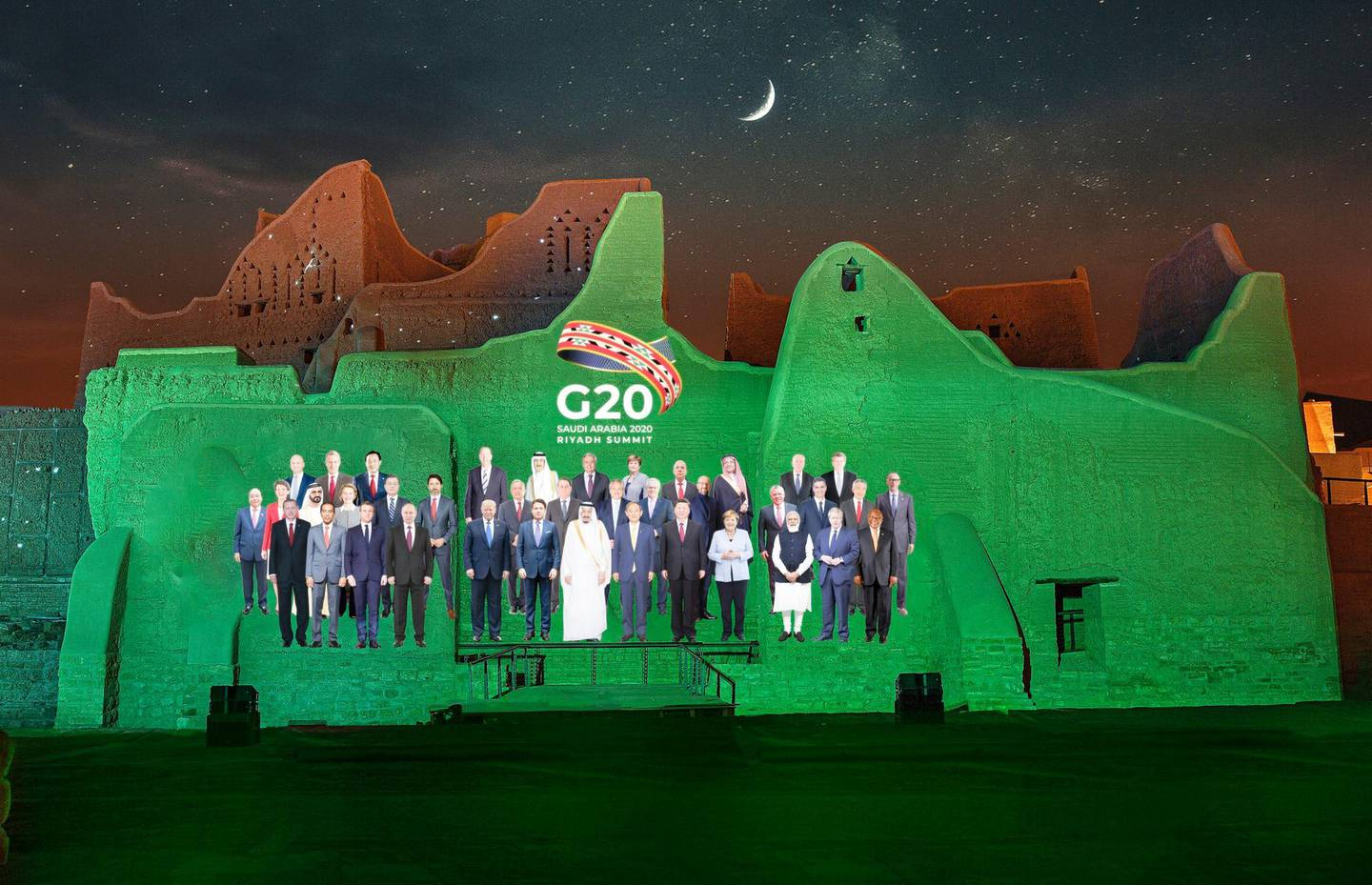 In this handout image provided by DGDA, Diriyah Gate Development Authority of Saudi, a family photo featuring members of the G20 is projected onto the walls of Salwa Palace, At Turaif on Saturday, Nov. 20, 2020 in Diriyah, on the outskirts of Riyadh, Saudi Arabia. (Meshari-Alharbi, DGDA via AP)