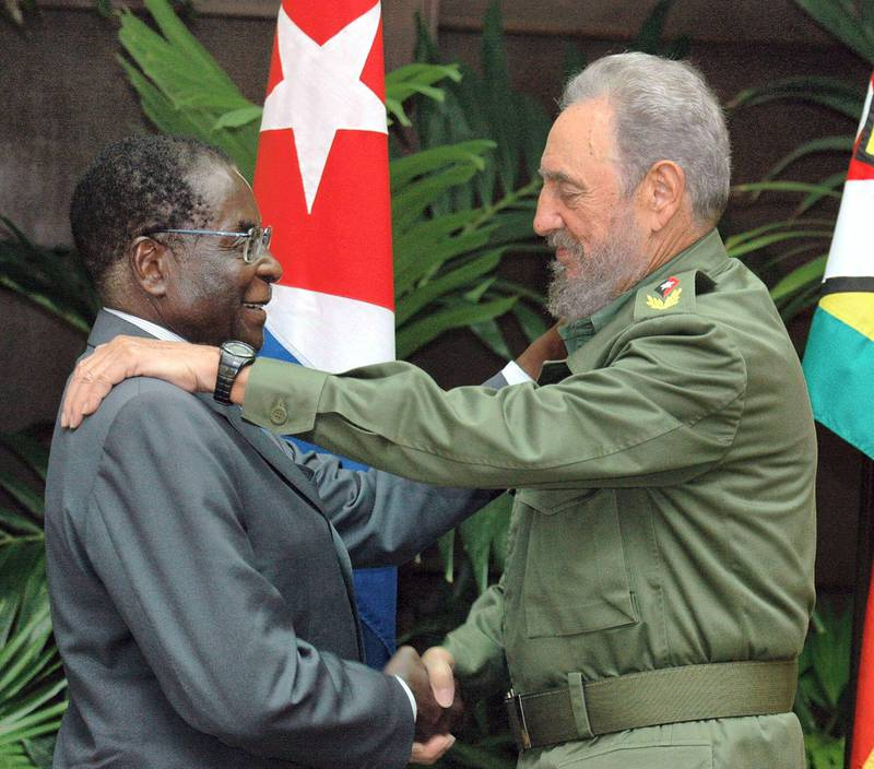 Mandatory Credit: Photo by Alejandro Ernesto/EPA/Shutterstock (8008731d)Cuban President Fidel Castro (r) Shakes Hands with Zimbabwe's President Robert Mugabe (l) Monday 12 September 2005 at the Revolution Palace in Havana (cuba) Mugabe is in Cuba For an Official Visit That Started on Saturday 10 September 2005 Cuba La HabanaCuba Zimbabwe - Sep 2005